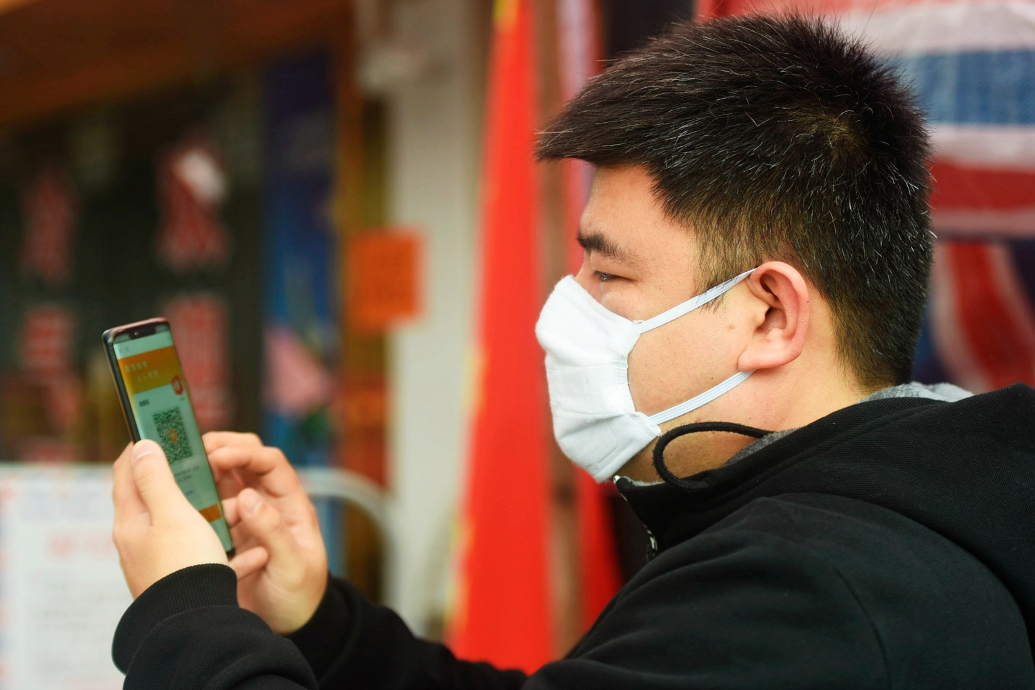 A man checks his health code in Hangzhou, China.