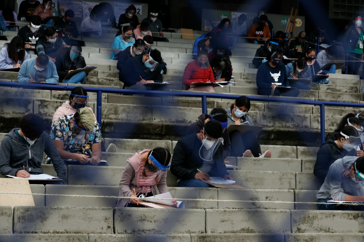 Students take an entrance exam in a stadium in Mexico City.