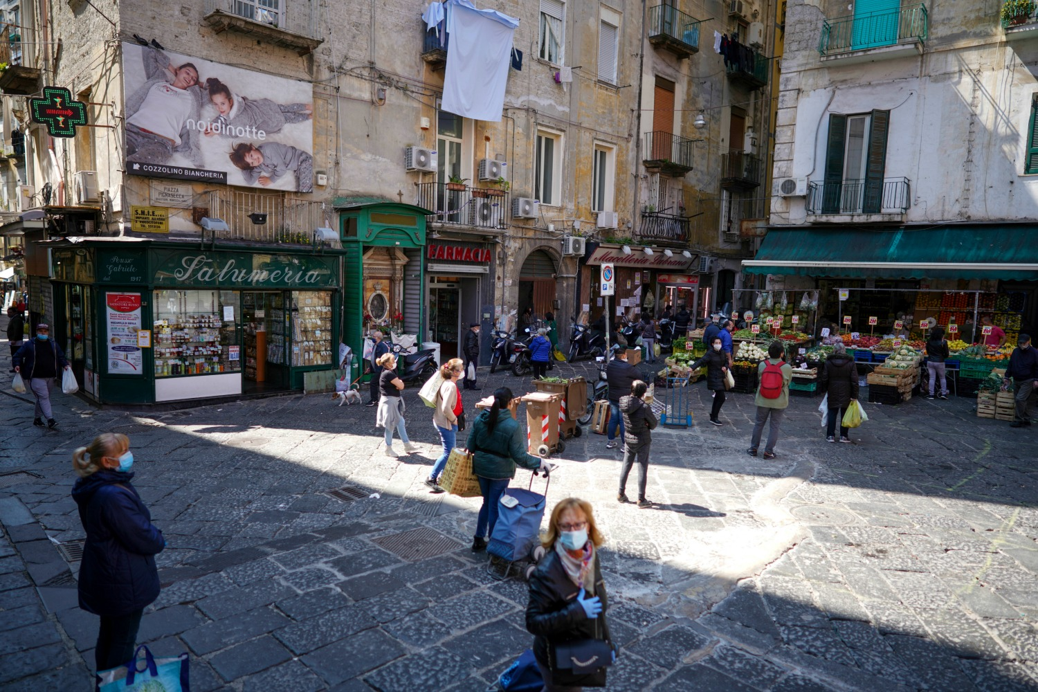 People shopping in Naples, Italy.